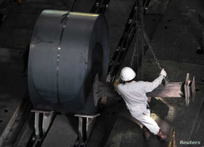 FILE - An employee works at the Baosteel Group Corp. factory in Shanghai. The steelmaker's executives are among leaders who've been investigated for corruption.
