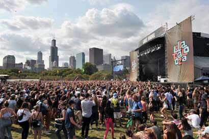 Fans watch day four performances as Charli XCX performs on day four at Lollapalooza in Grant Park, Aug 6, 2017 in Chicago. According to reports, the Las Vegas gunman also reserved rooms in Chicago, overlooking the Lollapalooza festival, but he did no...