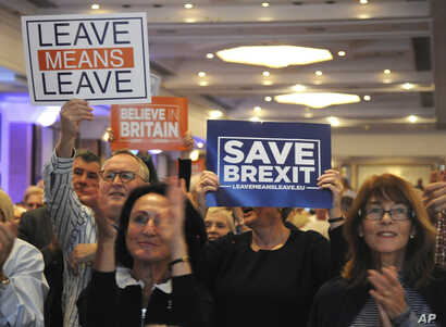 """FILE - Supporters during a """"Leave Means Leave Rally"""" are seen at the National Conference Center, Solihull, central England, Sept 30, 2018, as the ruling Conservative Party starts its annual conference."""
