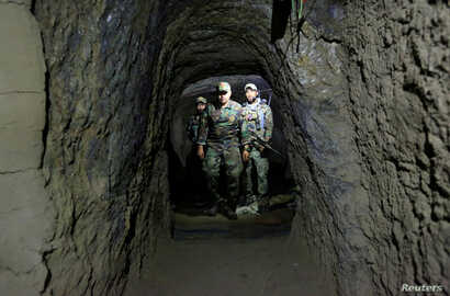 Afghan Special Forces inspect inside a cave that was used by suspected Islamic State militants at the site where a MOAB struck the Achin district of the eastern province of Nangarhar, Afghanistan, April 23, 2017.
