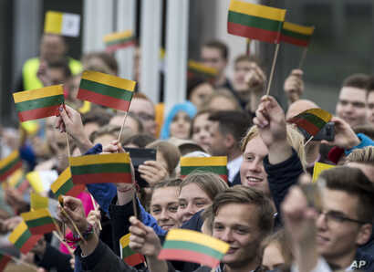 People wait for Pope Francis at Vilnius' airport, Lithuania, Sept. 22, 2018.
