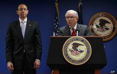 Attorney General Jeff Sessions, joined by Deputy Attorney General Rod Rosenstein, left, speaks news conference at the Attorney's Office for the District of Columbia in Washington, Oct. 15, 2018, to announce on efforts to reduce transnational crime.
