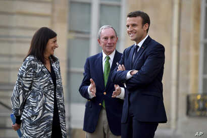 French President Emmanuel Macron (right) Paris mayor Anne Hidalgo and former mayor of New York City Michael Bloomberg talk during their meeting at the Elysee Palace in Paris, June 2, 2017.