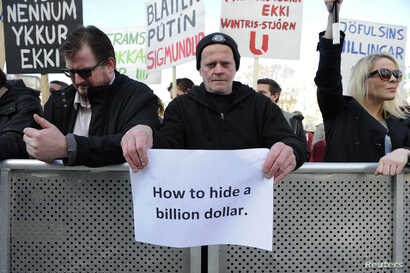 People demonstrate against Iceland's Prime Minister Sigmundur Gunnlaugsson in Reykjavik, Iceland on April 4, 2016 after a leak of documents by so-called Panama Papers stoked anger over his wife owning a tax haven-based company with large claims on th