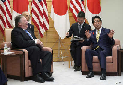 U.S. Secretary of State Mike Pompeo, left, and Japanese Prime Minister Shinzo Abe speak during a meeting at Abe's office in Tokyo, Oct. 6, 2018. Pompeo was in Tokyo for talks with Japanese officials ahead of his trip to North Korea.