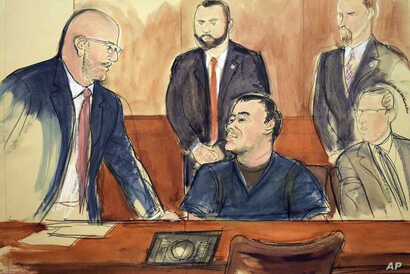 "In this courtroom drawing, Joaquin ""El Chapo"" Guzman, seated center, speaks to his attorney, Eduardo Balarezo, after a judge denied his request to speak directly to the court, Feb. 15, 2018, in New York."