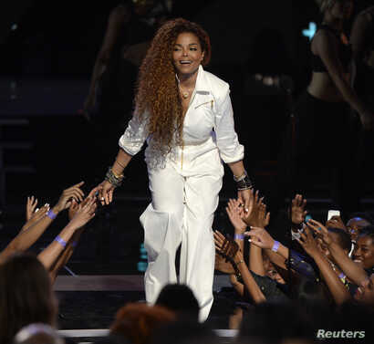 Janet Jackson takes the stage to accept the Ultimate Icon Award during the 2015 BET Awards in Los Angeles, California, June 28, 2015.