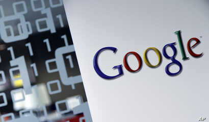 FILE - The Google logo is seen at the Google headquarters in Brussels, March 23, 2010.
