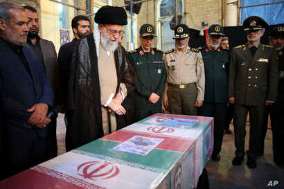 FILE - In this photo released by the official website of the office of Iran's supreme leader, Ayatollah Ali Khamenei attends the state funeral of Mohsen Hojaji, a young Revolutionary Guard soldier how was beheaded in Syria by the Islamic State group,...