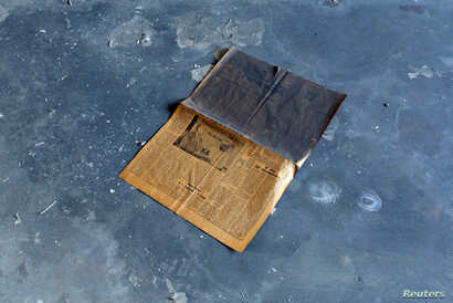 A Komsomolskaya Pravda newspaper dating from 1988 lies on the floor in a building that was once apartments where Russian doctors and soldiers lived with their families, at a former Soviet military hospital, which lies derelict since 1991 when the las...