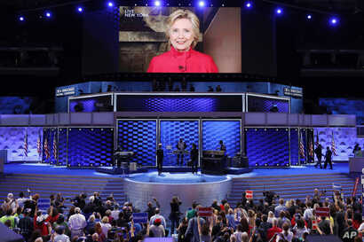 Democratic Presidential candidate Hillary Clinton appears on a large monitor to thank delegates during the second day of the Democratic National Convention in Philadelphia, July 26, 2016.