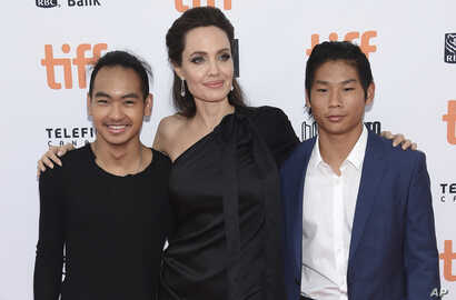 "Maddox Jolie-Pitt, from left, Angelina Jolie and Pax Jolie-Pitt attend a premiere for ""First They Killed My Father"" on day 5 of the Toronto International Film Festival at the Princess of Wales Theatre, Sept. 11, 2017, in Toronto."