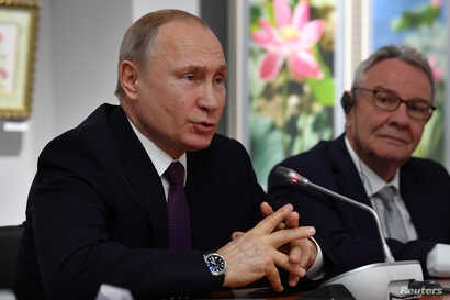 Russian President Vladimir Putin speaks during a meeting with a group of French politicians visiting Crimea, in Simferopol, March 18, 2019.