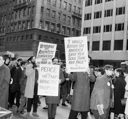 Pickets demonstrating for peace, join the march up fifth Avenue, between 52nd and 53rd street in New York, April 10, 1966.