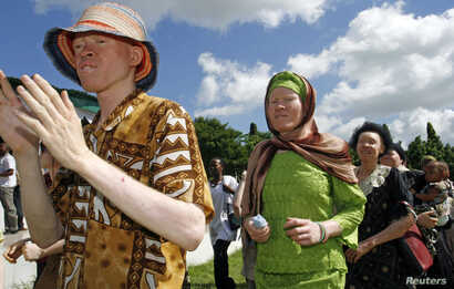 FILE - Participants march towards Mnazi Mmoja grounds during Tanzania Albino Day celebrations in Dar es Salaam.