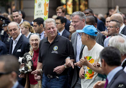 From left, French Foreign Minister Laurent Fabius, primatologist Jane Goodall, former U.S. Vice President Al Gore, New York Mayor Bill de Blasio, and  U.N. Secretary General Ban Ki-moon participate in the People's Climate March in New York, Sept. 21,...