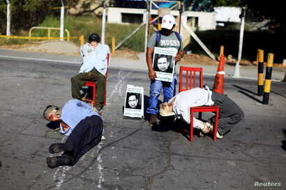 Mannequins depicting torture victims are left by demonstrators protesting against former Salvadoran army General Jose Guillermo Garcia prior to Garcia's arrival, at El Salvador International Airport in San Luis Talpa, Jan. 8, 2016. The U.S. deported