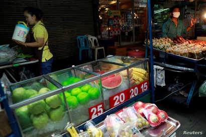 Street vendors sell food in a street in Bangkok, Thailand, Sept. 12, 2018.