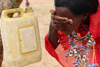 A woman washes her face. Facial cleanliness is one way to prevent Trachoma, Kajiado, Kenya. (Mohammed Yusuf for VOA)