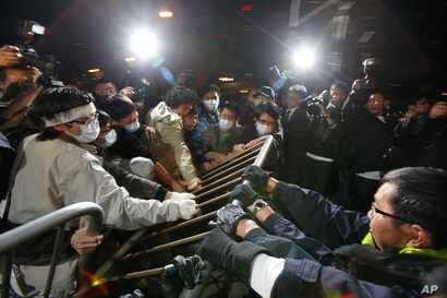 FILE - Protesters scuffle with police officers during a protest outside Hong Kong's Legislative Council, Jan. 16, 2010, after a controversial $8.6 billion plan to link Hong Kong to a national high-speed rail network won approval from local lawmakers....