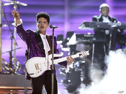 """Bruno Mars performs """"Let's Go Crazy"""" during a tribute to Prince at the 59th annual Grammy Awards on Feb. 12, 2017, in Los Angeles."""