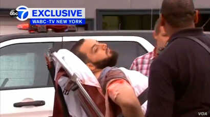 A still image captured from a video from WABC television shows a conscious man believed to be New York bombing suspect Ahmad Khan Rahami being loaded into an ambulance after a shoot-out with police in Linden, New Jersey, Sept. 19, 2016.