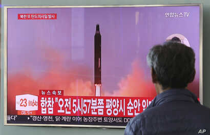 A man watches a TV screen showing a file footage of North Korea's missile launch, at the Seoul Railway Station in Seoul, South Korea, Aug. 29, 2017.