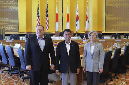 From left, U.S. Secretary of State Mike Pompeo, Japan's Foreign Minister Taro Kono, and South Korea's Foreign Minister Kang Kyung-wha pose for photo at the Iikura Guest House in Tokyo, Japan, July 8, 2018.