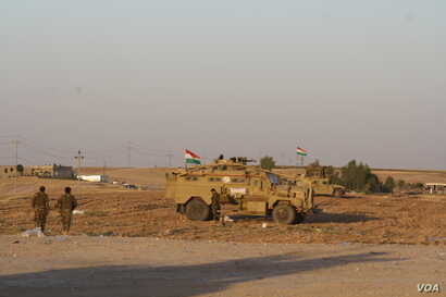 Peshmerga soldiers largely retreated from Kirkuk a week ago, but on Oct. 20, 2017 the armed force fought fiercely to maintain their lines outside Altun Kobri, a disputed area of northern Iraq. (H.Murdock/VOA)