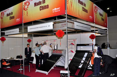 FILE - People visit China's booth at a solar exhibit in Johannesburg, South Africa, March 2, 2011. China's presence at the exhibit was seen as a show of commercial muscle highlighting Beijings's growing investment in Africa.