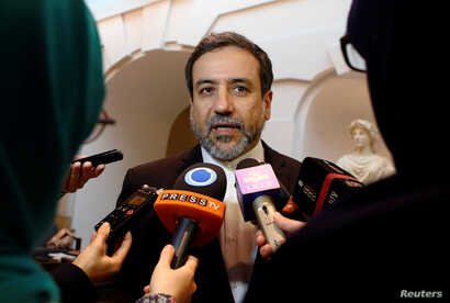 FILE: Iran's top nuclear negotiator, Abbas Araqchi, talks to journalists after meeting senior officials from the United States, Russia, China, Britain, Germany and France in a hotel in Vienna, Austria, Oct. 19, 2015.