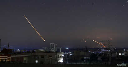 Missile fire is seen over Daraa, Syria, May 10, 2018.