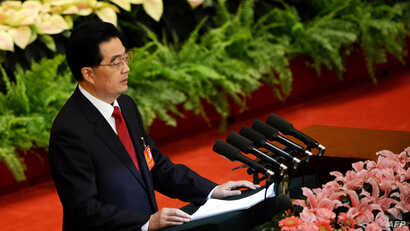 Chinese President Hu Jintao delivers his address at the opening of the 18th Communist Party Congress at the Great Hall of the People in Beijing, November 8, 2012.