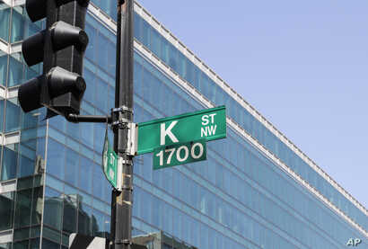 FILE - Known as a center for lobbyists, lawyers, and think tanks, the K Street corridor is seen in northwest Washington at 18th Street, May 3, 2018.
