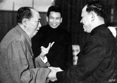 "FILE - A photo taken in the 1970 outside of Cambodia, shows China's chairman Mao Ze Dong, left, greeting top Khmer Rouge official Ieng Sary, right, also known as "" brother number three,"" while Khmer Rouge leader Pol Pot, center, looks on."