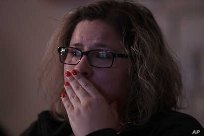 Angelica Magana, 34, a Dreamer, who was brought to the United State at the age of eight, reacts to President Donald Trump as he lays out is immigration policy during a State of the Union watch party in Chicago, Jan. 30, 2018.