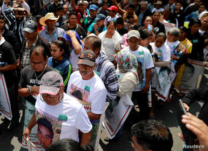 Relatives of 43 missing students who disappeared on Sept. 26, 2014 demonstrate outside the Museum of Memory and Tolerance after a meeting with Mexico's President-elect Andres Manuel Lopez Obrador in Mexico City, Mexico Sept. 26, 2018.