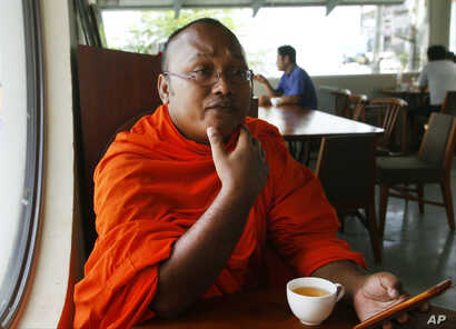 "FILE - Cambodian Buddhist monk But Buntenh speaks during an interview about killing of prominent political analyst Kem Ley in Phnom Penh, Cambodia, Nov. 21, 2016. ""The death of Kem Ley is the death of human rights in Cambodia. It is the silencing o..."