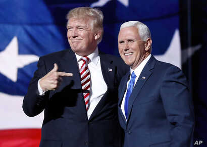 Republican presidential candidate Donald Trump, points toward Republican vice presidential candidate Indiana Gov. Mike Pence after Pence's acceptance speech during the third day session of the Republican National Convention in Cleveland.