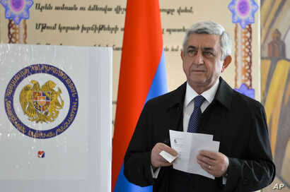 Armenia's President Serzh Sargsyan prepares to casts his ballot at a polling station during a parliamentary election in Yerevan, Armenia, April 2, 2017.