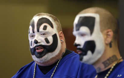 FILE - Joseph Bruce, aka Violent J, left, and Joseph Utsler, aka Shaggy 2 Dope, members of the Insane Clown Posse, address the media in Detroit. The U.S. Justice Department is asking a judge to dismiss a lawsuit by Insane Clown Posse, which objects t...