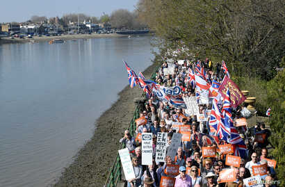 Pro-Brexit protesters take part in the March to Leave demonstration, as they walk along the River Thames, in London, Britain, March 29, 2019.