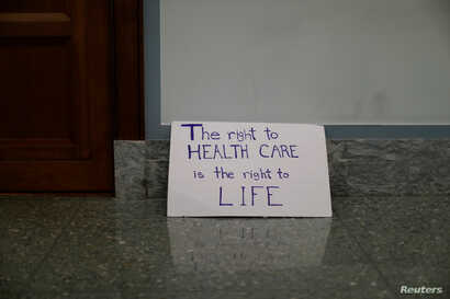A sign is left behind after a demonstration against the latest Republican effort to repeal and replace the Affordable Care Act in Washington, Sept. 25, 2017.