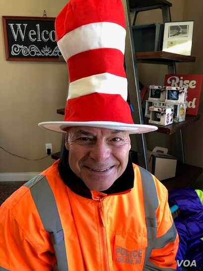 In the past five years, Woolford has collected 55 hats to wear as he directs traffic outside Ashland's middle and high schools. (Courtesy Photo).