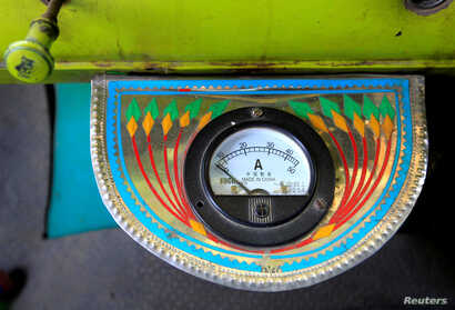 An electric gauge is seen in the cab of a decorated truck in Faisalabad, Pakistan, May 4, 2017.
