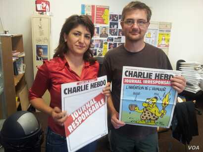 Stephane Charbonnier, right, editor-in-chief of the French publication Charlie Hebdo, was interviewed in 2012 by VOA's Arzu Çakır. Charbonnier was killed in an attack that left at least 12 people dead, in Paris, France, Jan. 7, 2015.