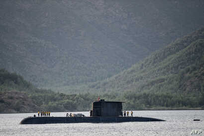 A Turkish navy submarine cruises on Sept. 20, 2017, off the Turkish Naval base of Aksaz in Marmaris, during a NATO submarine escape and rescue exercise.