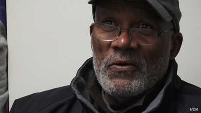 """""""A lot of us out here that can't vote honestly feel in our heart that we are just existing,"""" says John, a former convict from New York. (R. Taylor/VOA)"""