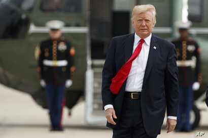 President Donald Trump walks from Marine One to board Air Force One for a trip to Miami to deliver a speech on Cuba policy, June 16, 2017, at Andrews Air Force Base, Md.