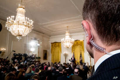 FILE - A Secret Service agent stands as President Donald Trump speaks during a news conference in the East Room of the White House in Washington, Feb. 16, 2017.